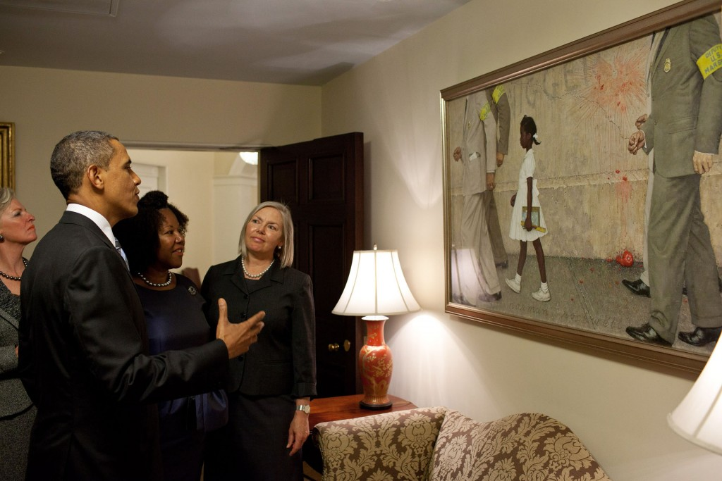 "President Barack Obama, Ruby Bridges, and representatives of the Norman Rockwell Museum view RockwellÕs ""The Problem We All Live With"", hanging in a West Wing hallway near the Oval Office, July 15, 2011. Ruby Bridges is the girl in the painting. (Official White House Photo by Pete Souza)"